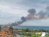 За Феодосией горит камыш, столб дыма над заливом