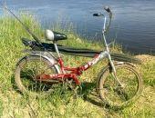 В Москве рыбак поймал на удочку велосипед и пистолет