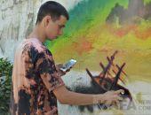 На стене за Светомузыкальным фонтаном появились живописные граффити:фоторепортаж