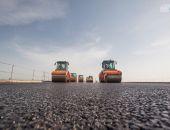 Строители уложили первые 600 метров асфальта на участке Крымского моста (фото) (видео)